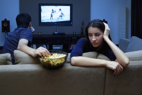 Couple-watching-TV-woman-upset