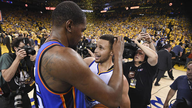 May 30, 2016; Oakland, CA, USA; Golden State Warriors guard Stephen Curry (30, right) is congratulated by Oklahoma City Thunder forward Kevin Durant (35) after game seven of the Western conference finals of the NBA Playoffs at Oracle Arena. The Warriors defeated the Thunder 96-88. Mandatory Credit: Kyle Terada-USA TODAY Sports